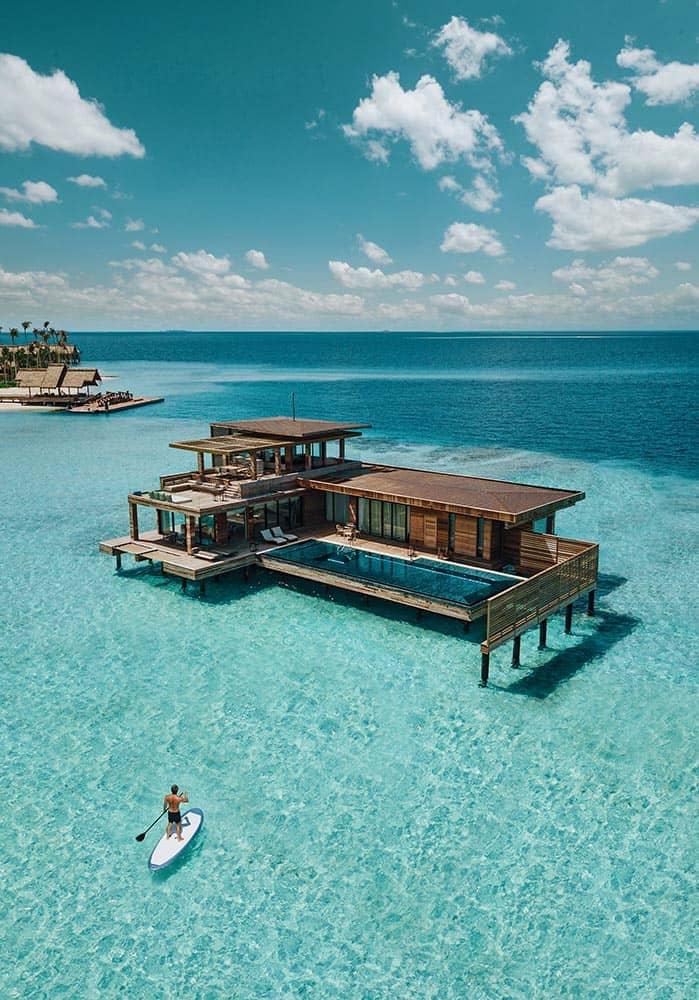 Resort Waldorf Astoria Maldives Ithaafushi Villa Stella Maris Paddleboarding, фото